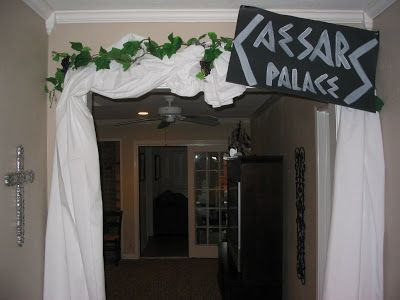 Drape sheets around railing. secure the zip ties. Use Garland/greenery to cover up the zip ties