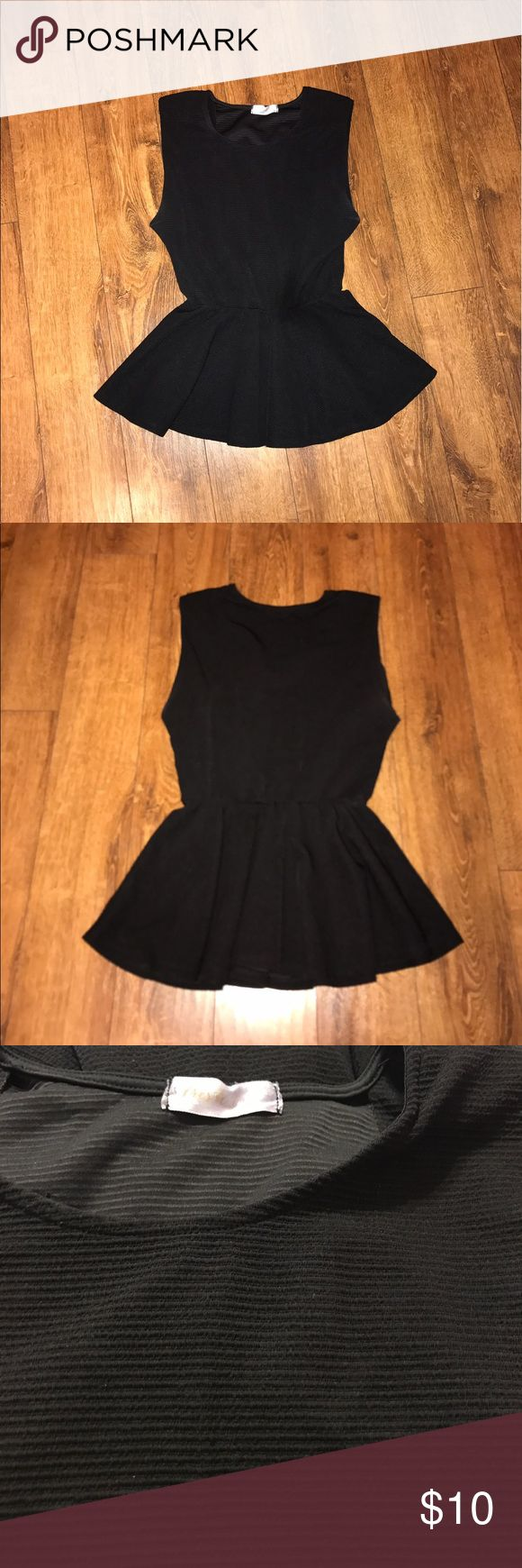 Black peplum top Great condition. Thick banded material. Sleeveless. Elastic waistband. Very flattering. Tops Tank Tops