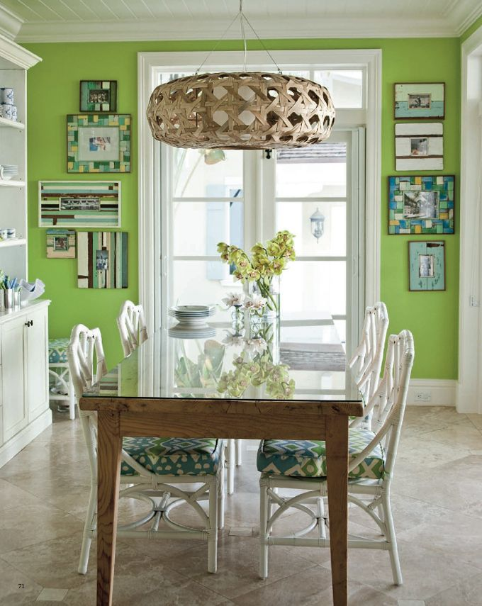 Love the frames and the light fixture.  And the happy green paint.  And the dining room chairs upholstery