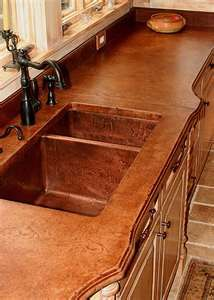 Cement countertop with sink. Shows a lot of different pictures of countertops. neat ideas!