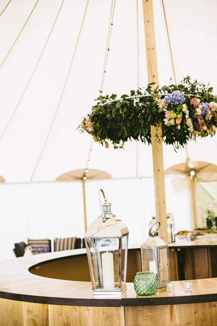 wedding reception at home ideas uk%0A Sperry interior with circular oak bar and hanging floral crown  flowers by  Lucy MacNicoll Floral  Wedding TrendsWedding IdeasWedding ReceptionFloral