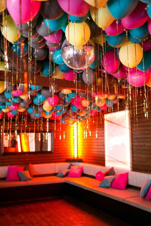 relaxed wedding reception details with colourful balloon decorations