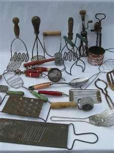 Old kitchen utensils.  Barbedwire wreath at outdoor kitchen has this type stuff on it.