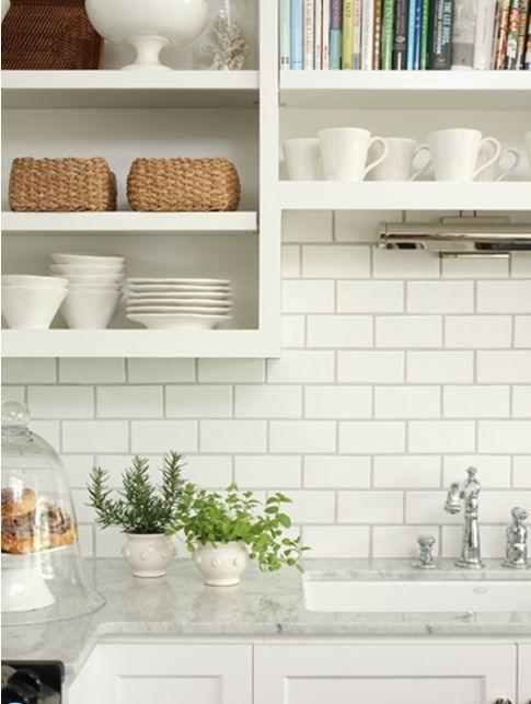 kitchen close up backsplash white subway tiles dark grey grout open shelving shelves marble countertops white