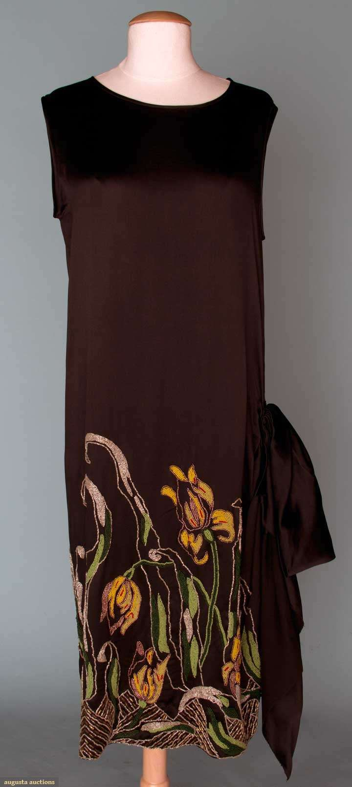 FLAPPER DRESS, BEADED IRIS, 1920s Black silk satin, large bow on L hip, F & B skirt beaded in yellows, greens, white, red & copper depicting spring garden w/ iris & tulips.