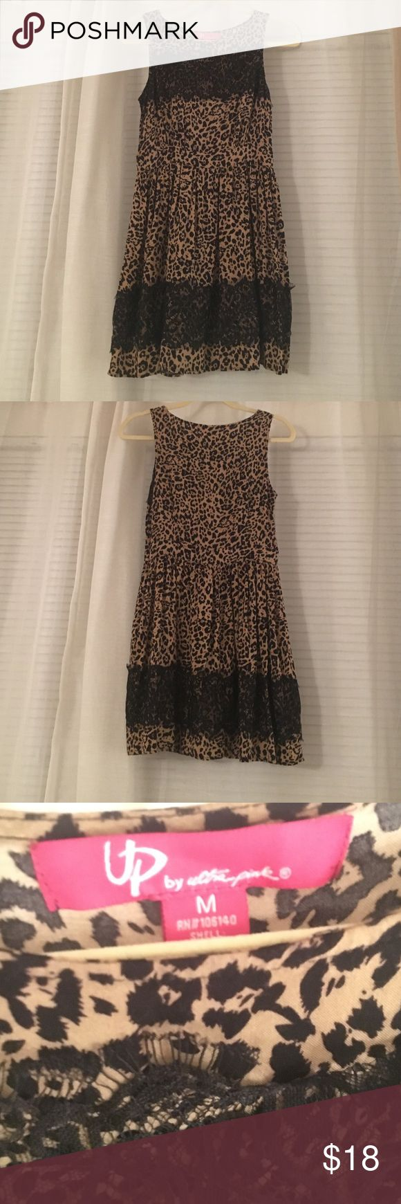 Cheetah Print Dress This cheetah Print dress is detailed with black lace. Very cute and flowy. Dresses
