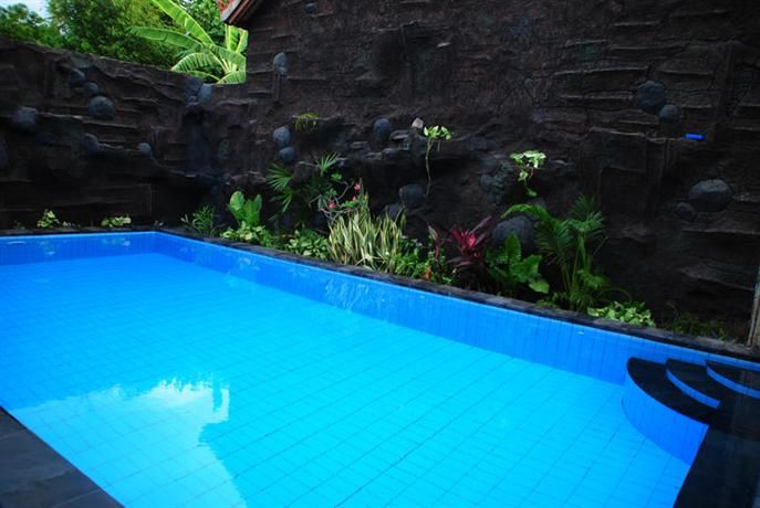 OopsnewsHotels - Dimpil Homestay. Dimpil Homestay offers a comfortable setting while in Pemuteran. It is ideal for those wanting to get back to nature, with West Bali National Park just moments away.   There are a range of facilities available to those staying at the hotel, such as a car rental desk and bicycle rental.   There are 8 rooms at Dimpil Homestay, each offering all the essentials to ensure a comfortable stay.