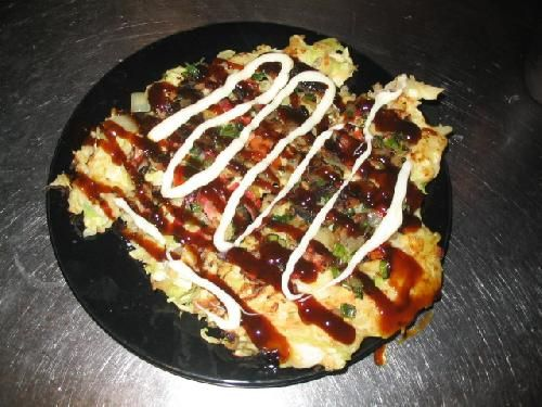 """Literally means """"cooked favorites."""" Okonomiyaki specialties differ by regions. In Hiroshima, Okonomiyaki is thick, sometimes layered with eggs and yakisoba. Most foodies will claim that Osaka is home to the best Okonomiyaki dishes. Veggie pancakes. These patties may remind you of Tempura but are really quite different. Serve them with a nice spicy sauce, soy sauce, or visit your local asian grocery store and buy traditional Okonomiyaki sauce (a sweet asian BBQ flavored sauce.) Some ..."""