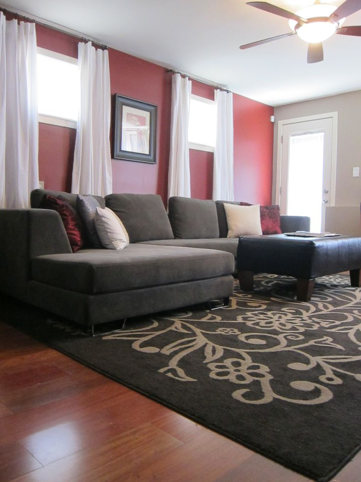 A philadelphia tv host 39 s home complete with a red accent for Grey and red living room ideas