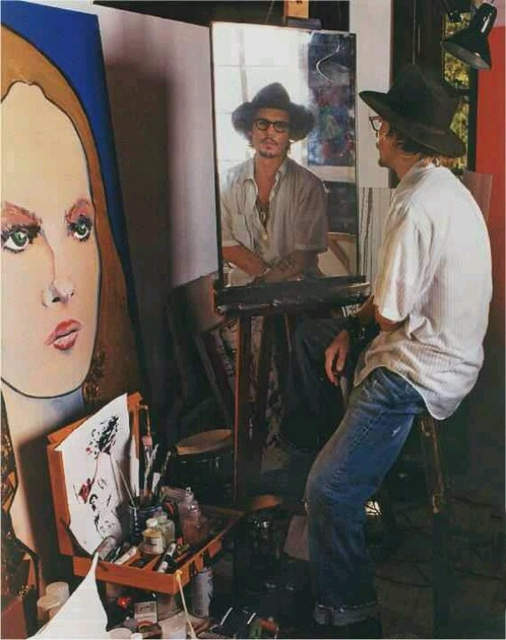 Johnny Depp in his art studio at home in Hollywood where he enjoys one of his other artistic endeavors - painting. The painting shown is of Vanessa Paradis.