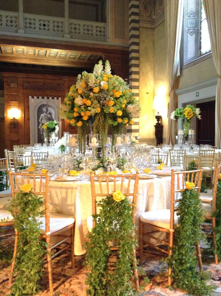 Mixed flowers centerpiece. Greenery garland with flower to decorate the chairs.