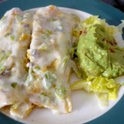 Beef and Cheese Enchiladas con Queso. Need to add seasoning. Was quite bland.