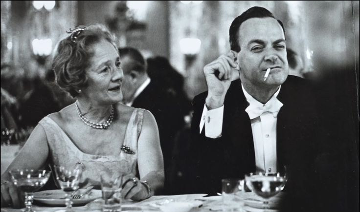 Richard Feynman at the Nobel Awards dinner after receiving his prize in Physics.  Who is the woman to Feynman's right?