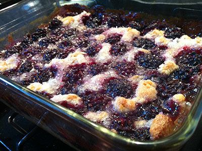 Bates blackberry cobbler. Ingredients: 1 stick butter 1 cup self-rising flour 1 cup milk 1 cup white sugar 1/2 teaspoon vanilla Blackberries (or other fruit)  Instructions: Preheat oven to 350 degrees. In the pan you will use to make cobbler, place the butter and put pan in hot oven so butter melts.   In a separate bowl, combine self-rising flour, milk, sugar & vanilla. Mix well  Pour batter into hot pan with butter. Bake at 350 deg for 45-60 mins.
