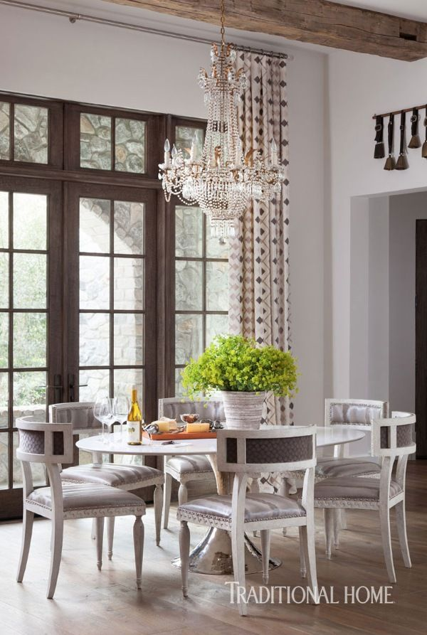 """The """"Dakota"""" hammered-and polished-nickel table base from Julian Chichester is topped with white marble. - Photo: Ryann Ford / Design: Julie Dodson"""