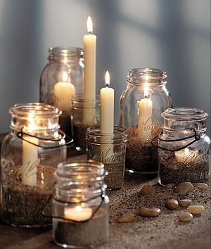 All you need is a mason jar, candles, and sand or stones. Simply fill your jar with sand to your preferred height and nestle a candle into the middle.  That's it! Try giving these more impact by grouping a few together in varying heights, or line a bunch together to create a beautiful runner down the center of your table.  You can even skip the sand all together and just stick to candles of varying heights in each jar.  This no-fuss mason jar centerpiece will bring a touch