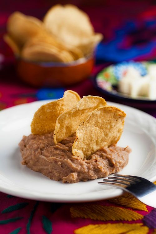 This is the way of serving the Refried Beans… with tortilla chips, bread and cheese. What a delight!