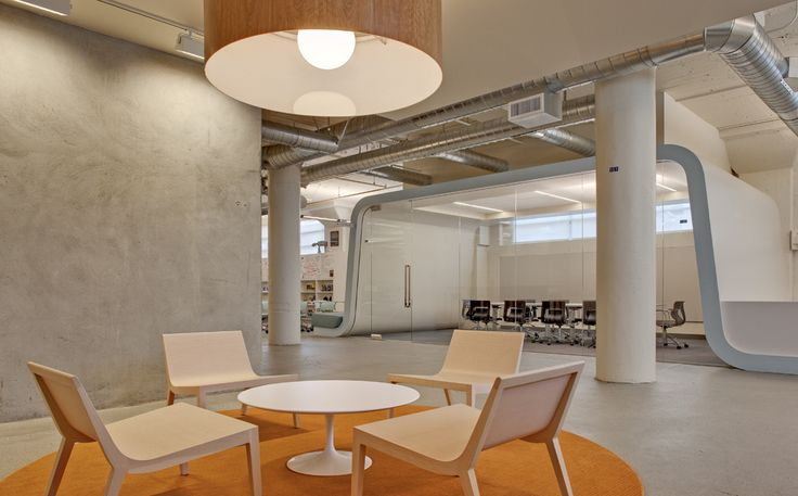 Exposed mechanical systems become a design element against the white open ceilings.