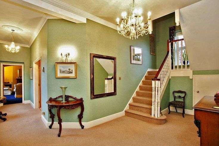 photo of classic beige green olive sage entrance hall with chandelier