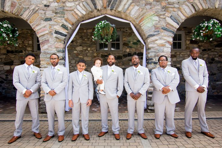 The best man and the groom both have white ties and the groomsmen have grey to match the suit. We love this sleek look with the brown shoes. Photographer: Future Focus Media | Venue: Castle Farms - Queen's Courtyard