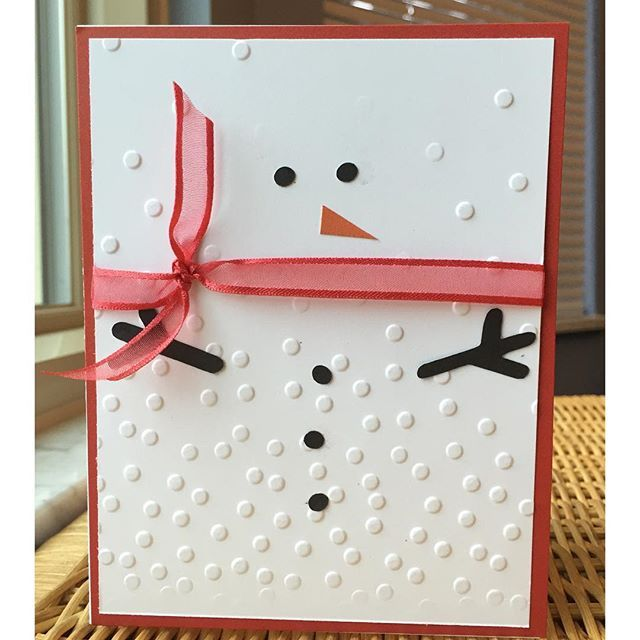 Snowman card made with embossing folder and diffuser. The diffuser leaves a smooth space for the face.