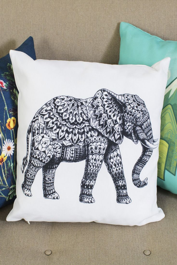 We love this gorgeous elephant line drawing, perfect on a throw pillow. Black and white, intricate lines print crisp and clear on soft, poly-poplin fabric from Redbubble.