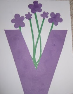 v is for violets in a vase
