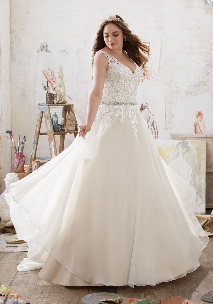 Frosted Venice Lace AppliquéŽs Adorn the Bodice of this Beautiful Chiffon Wedding Gown. A DiamantŽé Beaded Waistband Accents the Natural Waist and Adds the Perfect Touch of Sparkle