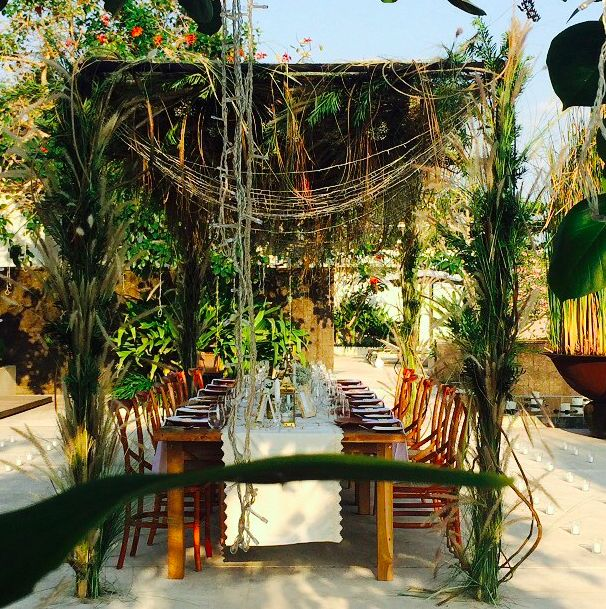 Rustic, tropical set up with our Natural cross backs & tables | Bali Event Hire www.balieventhire.com