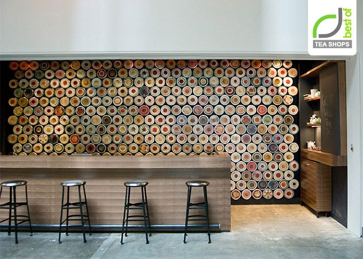 A staggered array of 568 standard tea containers are magnetized to create tea storage, signage and an ever changing display of imagery. It also lends the tea shop their name: Great Wall Tea Company. The long linear walnut counter is designed as a nod to the bar, where patrons lounge, sip and socialize.