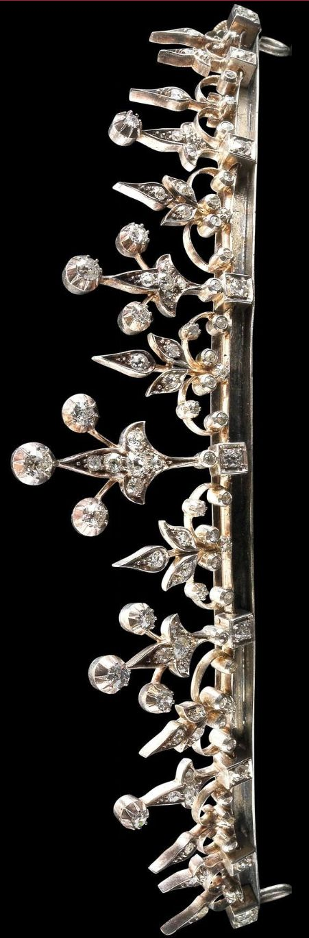 Diamond tiara, first half 19c. Can be worn as a necklace. Image the Dorotheum (http://www.dorotheum.com/en/auction-detail/auction-10843-jewellery/lot-1768104-a-diamond-diadem-total-weight-430-ct.html?no_cache=1&img=1&cHash=94164823beea9ba95d3bf2fa96099f6d)