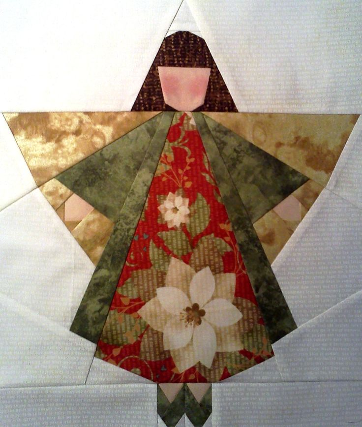 neatly pieced christmas angel block -- lots of potential with fabric choices here!!!!!