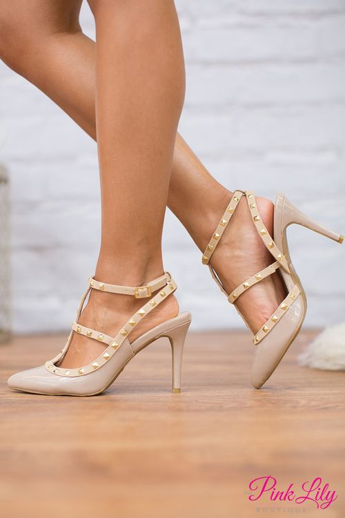 These edgy new heels are simply perfect for a girls night out! They feature nude material paired with a unique strap arrangement and golden studded details.