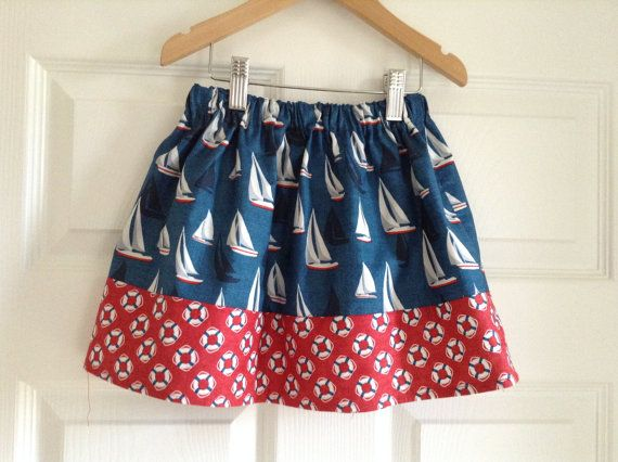 This skirt is made in gorgeous 100% cotton fabric from Makower who is a British Manufacturer. It has a fully elasticated waist and measures 11.25 inches in length. I have sized it that it would fit an average 3-5 year old. The main part of the skirt is a denim blue with sail boats and edged in red with lifebouys. This is the perfect little skirt for the summer. I would recommend washing at 30 degress and not tumble dry.  I do have have a small supply of the beach hut fabric left so can take…