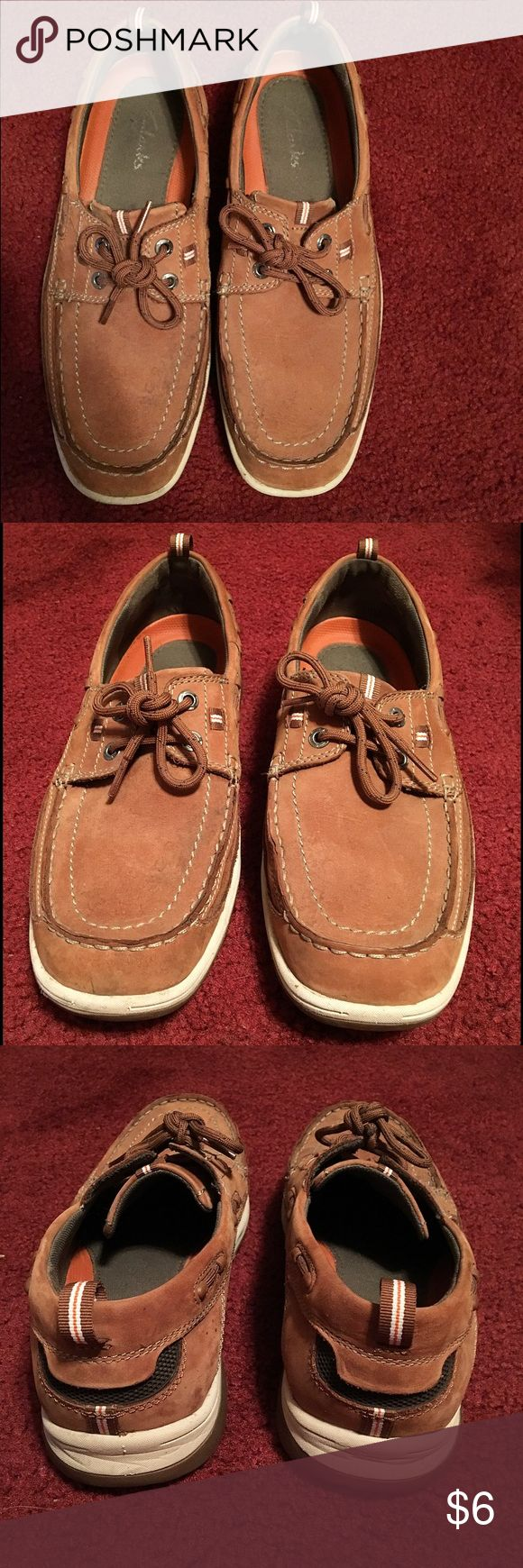 Clarks Men's Brown Boat Shoes Men's brown shoes (boat-like shoes) with lace in front. Comfortable to walk in and in good condition. Brown leather material with white and dark green accents. Used and shows wear but silk wearable! No trades. Clarks Shoes Boat Shoes