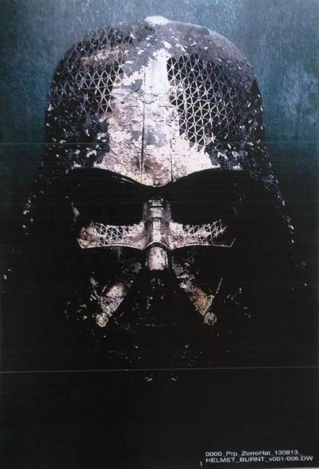 Darth Vader's helmet emerges in Star War 7 trailer.