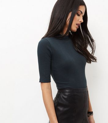 """I like this in a few colours. Bring this ribbed funnel neck top into your evening wardrobe. Great for finishing with black trousers and strappy heels.- Ribbed texture- Funnel neck- 1/2 sleeves- Slim fit that is closely cut- Soft cotton blend- Cassia is 5'9""""/175cm and wears UK 10/EU 38/US 6"""