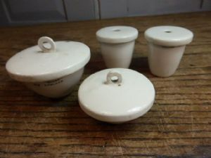 Set of 4 antique porcelain lidded laboratory containers