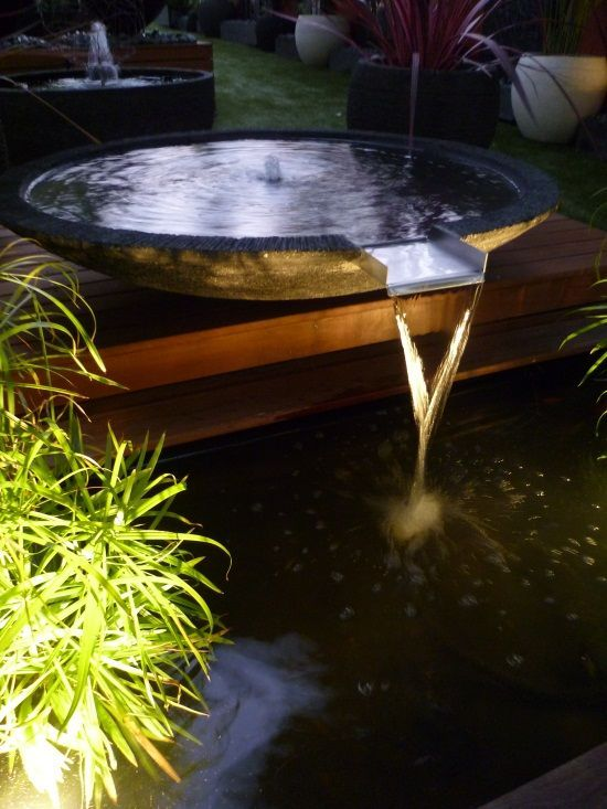 Low Bowl Water Feature Spilling Into A Koi Pond Www