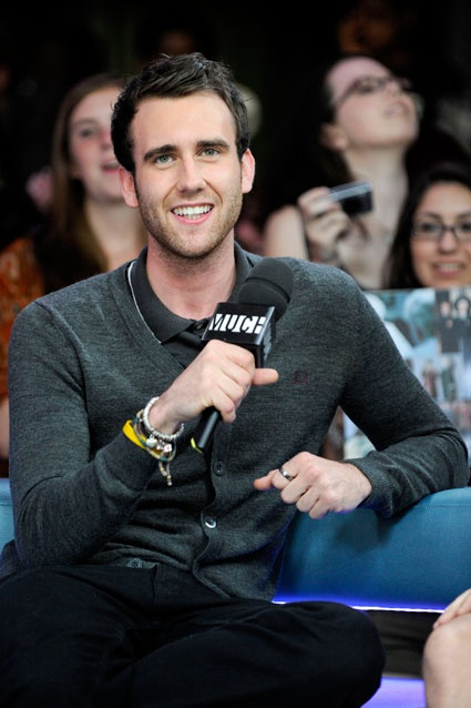 I still think it's hilarious that Neville Longbottom has turned into a hot sexy heart throb. Ugly children everywhere should rejoice.