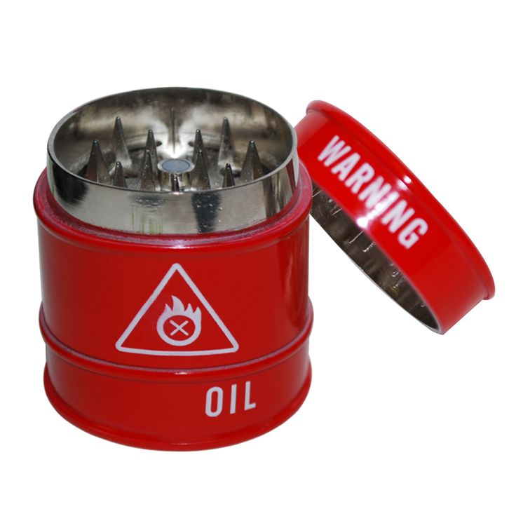 Warning Oil Cannister 3 Piece Barrel Red Grinder | Warning – highly inflammable! No, not the oil in this fake oil barrel but the state of your weed when it's been through the metal-toothed grinder. There'll be no OPEC embargo and if there is a blowout, it won't be a deep sea one. Vibrant red finish means you'll have trouble losing it.