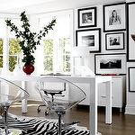 dens/libraries/offices - acrylic lucite chairs white lamp black white photo gallery den office West Elm Parson Desk Zebra Cowhide Rug  Modern