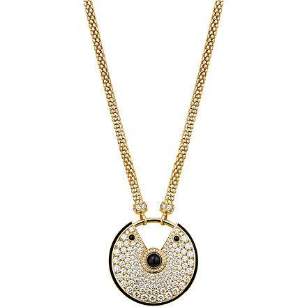 AMULETTE DE CARTIER NECKLACE Yellow gold, diamonds, onyx