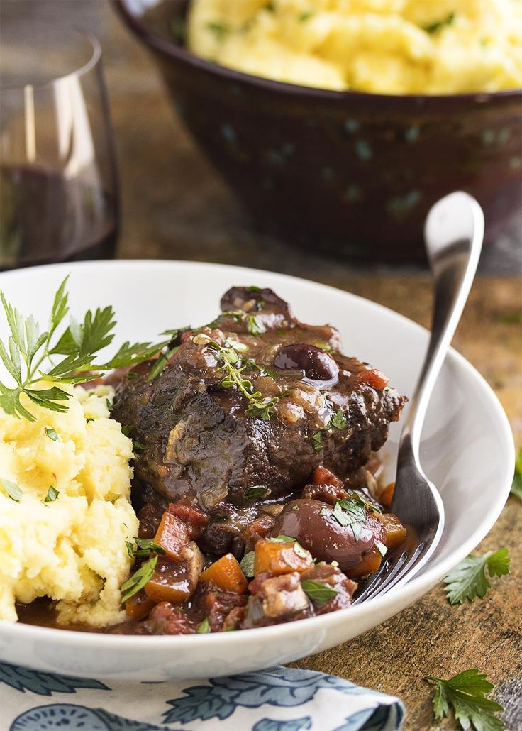 Beef short ribs are browned on the stove top and then oven braised for hours in red wine until they are meltingly tender in this recipe for french short ribs.   justalittlebitofbacon.com