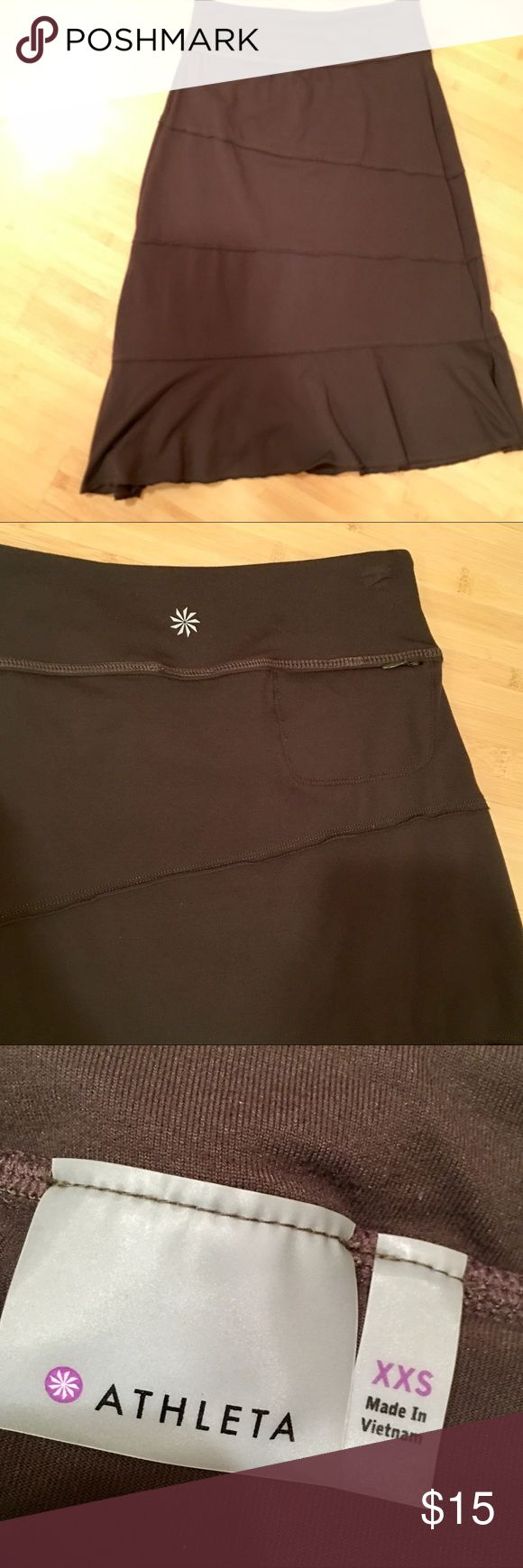 Athleta skirt - olive Athleta skirt with asymmetrical stitching  Fits snug on top and flows out. Great with flats or tennis shoes  Barely worn. Athleta Skirts Midi