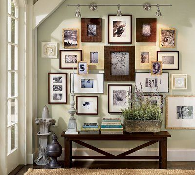 a nice idea for displaying all those photos - liking a mix of different frames and one big display