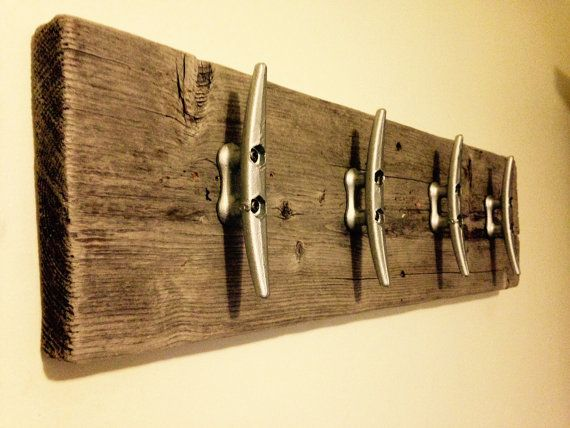 This Beach style coat rack is made from scavenged driftwood planks and cast iron dock cleats. It is the ideal coat rack for a nautical themed room