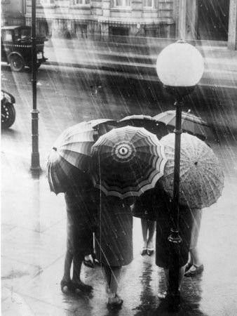 Ladies meeting in the rain?