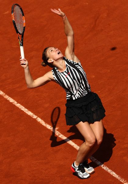 Simona Halep Photos - Simona Halep of Romania serves during the Ladies Singles second round match against Zarina Diyas of Kazakhstan at Roland Garros on May 25, 2016 in Paris, France. - 2016 French Open - Day Four