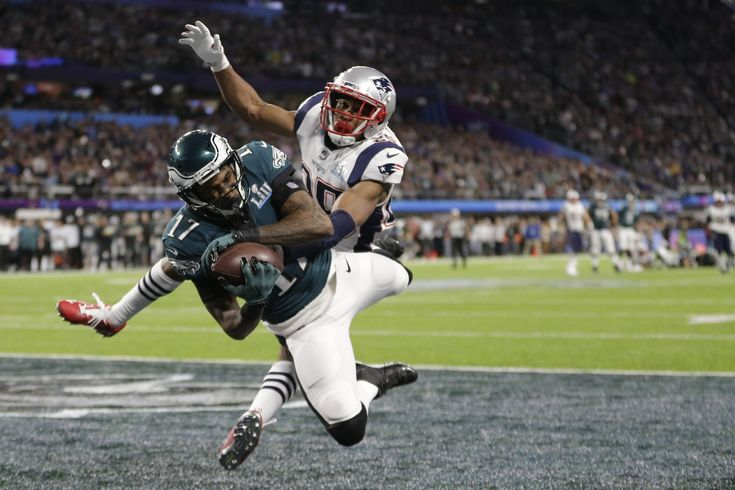 Super Bowl 2018 Live Updates: Eagles Lead Patriots in First Half - Philadelphia Eagles wide receiver Alshon Jeffery makes a catch for a touchdown under pressure from New England Patriots cornerback Eric Rowe in the first quarter. Credit AJ Mast for The New York Times - The New York Times